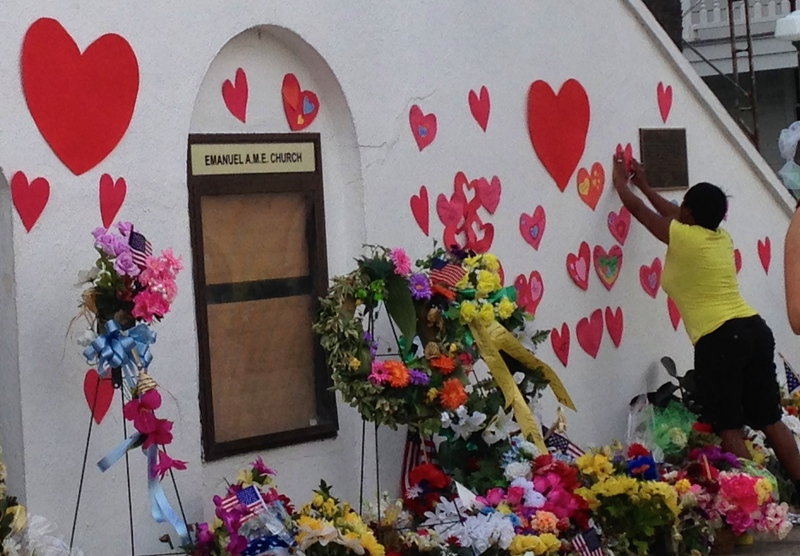 A woman places a heart on Emanuel AME Church at the Young Preservationists' event, photograph by Brittany Lavelle Tulla, July 8, 2015, Charleston, South Carolina.