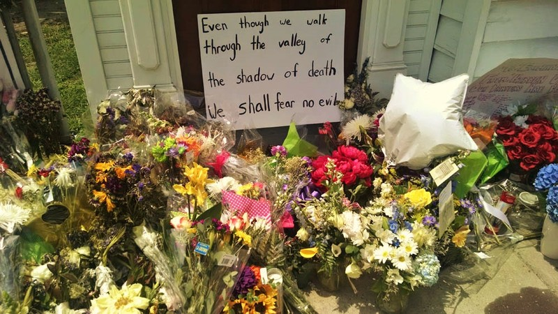A poster with a message from Psalm 23:4 left at the Emanuel AME Church, photograph by Toni Carrier, June 23, 2015, Charleston, South Carolina.