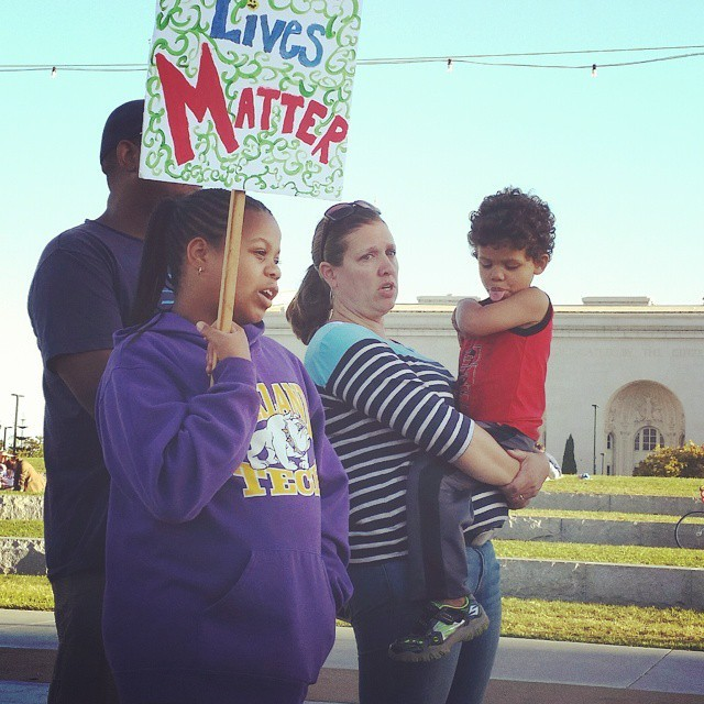 A young protester attending the Lake Merritt march, Instagram photograph by Pamela Drake, June 21, 2015, Oakland, California.