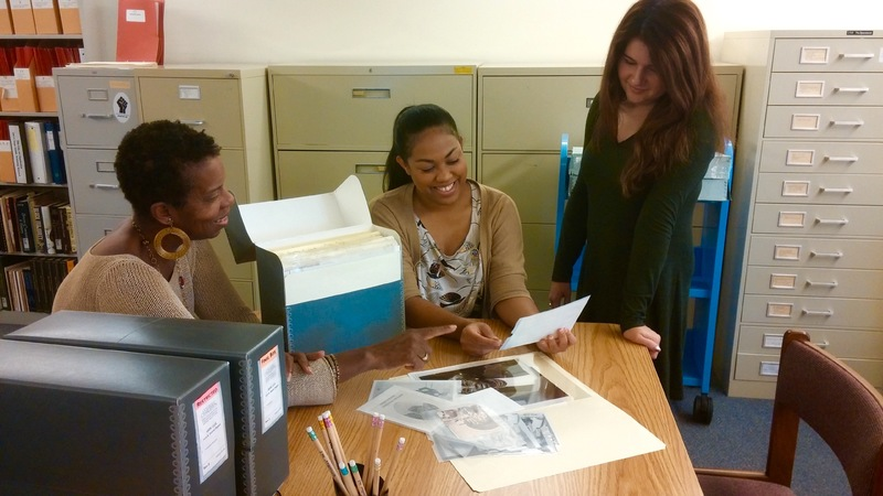 The Avery Research Center's processing archivist, Georgette Mayo (left), and reference and outreach archivist, Barrye Brown (center) with College of Charleston graduate student assistant Victoria Shaw (right) in the Phyllis Wheatley Reading Room, Charleston, South Carolina, 2015, courtesy of the Avery Research Center.