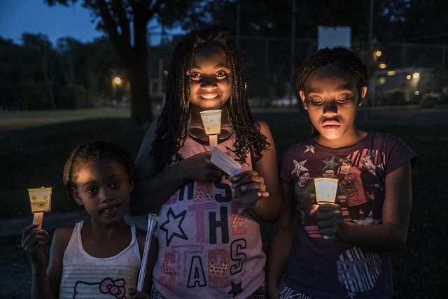 Young girls at Black Lives Matter vigil, June 19, 2015, Madison, Wisconsin, courtesy of Light Brigade.