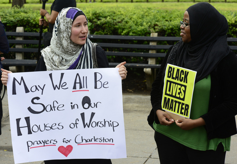 Participants holding signs at a vigil, photograph by Stephen Melkisethian, June 18, 2015, Washington, D.C.