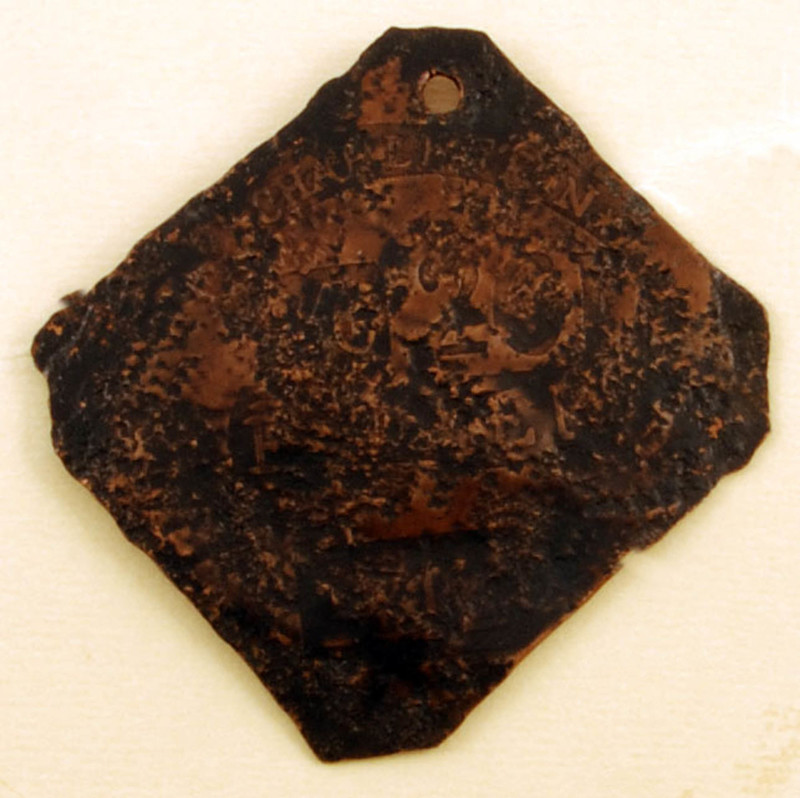 "Copper slave badge imprinted ""Charleston No. 261 Fruiterer 1812,"" Walter Pantovic Artifact Collection, courtesy of the Avery Research Center for African American History and Culture."