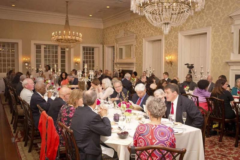 Guests socializing during Nat Fuller's Feast, photograph by Jonathan Boncek, Charleston, South Carolina, April 19, 2015.