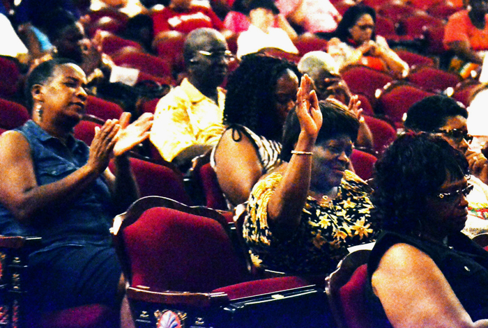 Community members gather at Stevenson Auditorium for a prayer vigil to remember the victims of the Emanuel AME Church shooting in Charleston, photograph by Christopher Huff, July 2, 2015, Orangeburg, South Carolina, courtesy of <em>The Times and Democrat.</em>
