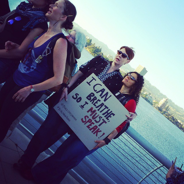 Marchers holding a sign at the Lake Merritt march and rally, Instagram photograph by Pamela Drake, June 21, 2015, Oakland, California.
