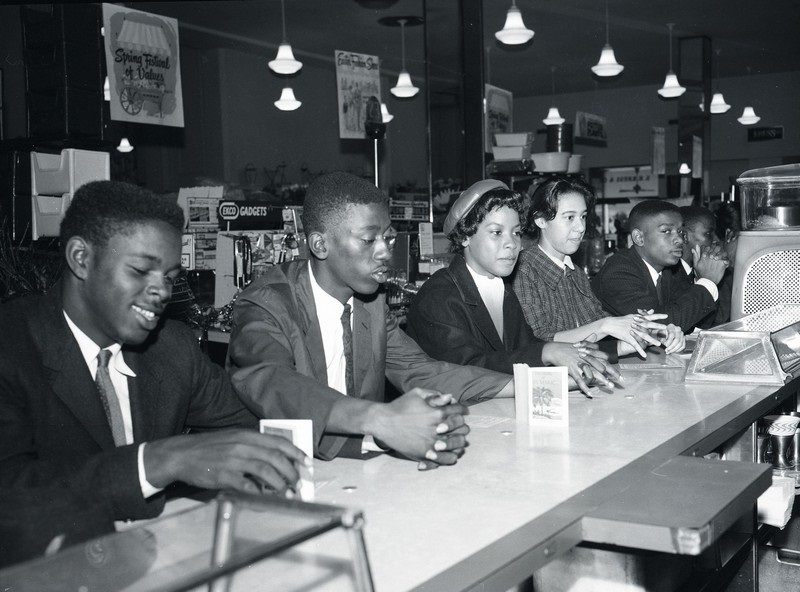 Burke High School students at a sit-in at the S.H. Kress store on King Street, Charleston, South Carolina, April 1, 1960, photograph by Bill Jordan, courtesy of the <em>Post and Courier</em>. Eugene Hunt, Avery graduate and Burke High School teacher, encouraged students to join this sit-in as&nbsp;challenge to segregationist policies and participate in the larger Charleston Movement for Civil Rights. Averyite J. Arthur Brown&rsquo;s daughter Minerva (fourth from left) was one of the participants.