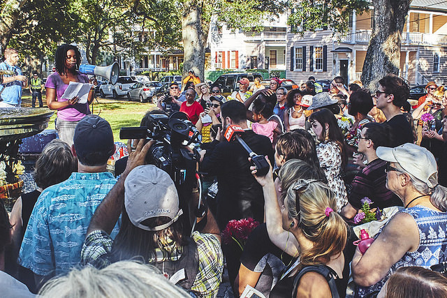 A leader at the Black Lives Matter march speaking to crowd, photograph by Zach NeSmith, June 20, 2015, Charleston, South Carolina.