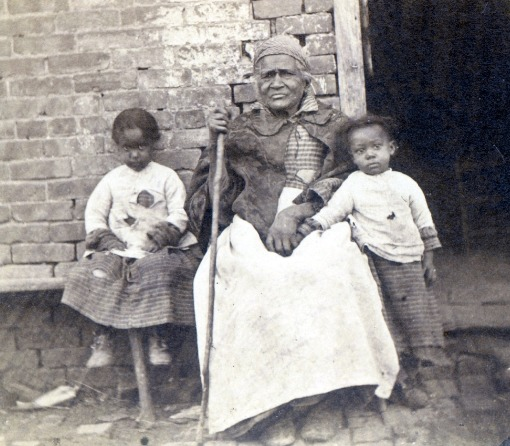 Photograph of formerly enslaved woman with her great granddaughters, 1867, courtesy of the General Public Library of America.