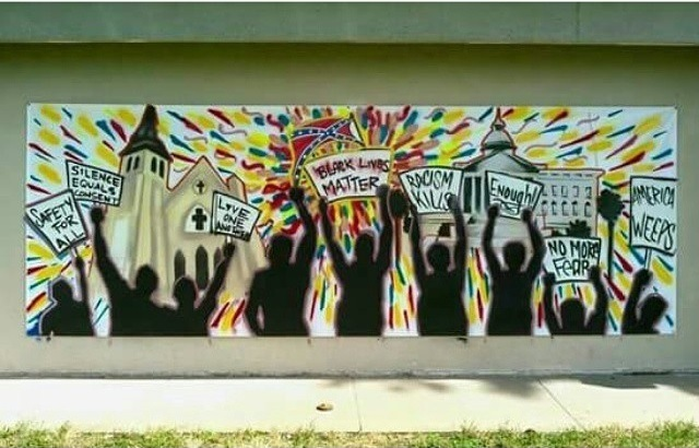 A mural addressing the mass shooting in Charleston painted by artists Ricardo Trejo and Samuel Agoitia, photograph by Armando Minjarez, July 2015, Wichita, Kansas.