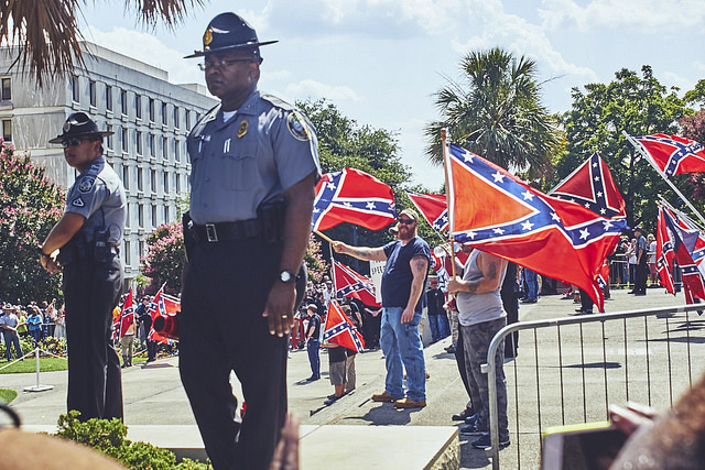 South Carolina State Troopers on duty at the South Carolina State House grounds for a Ku Klux Klan (KKK) rally in support of the Confederate flag after its removal on July 10th, photograph by Zach NeSmith, July 18, 2015, Columbia, South Carolina.