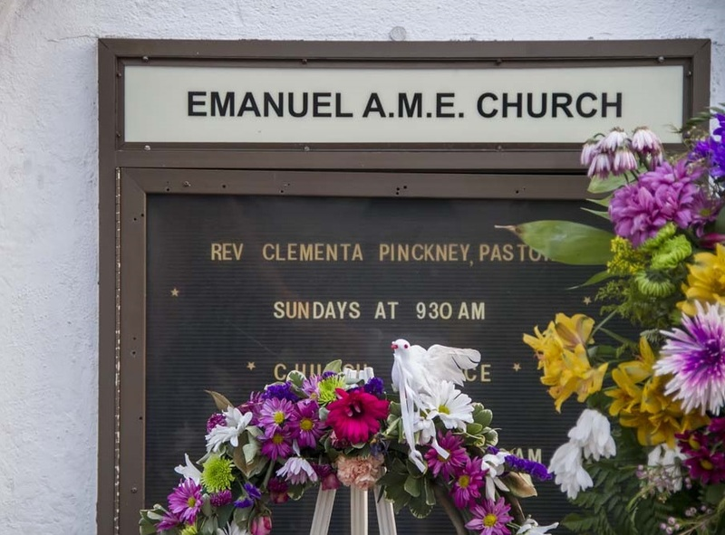 Flowers alongside the Emanuel AME Church information board, photograph by Brandon Coffey, June 29, 2015, Charleston, South Carolina.
