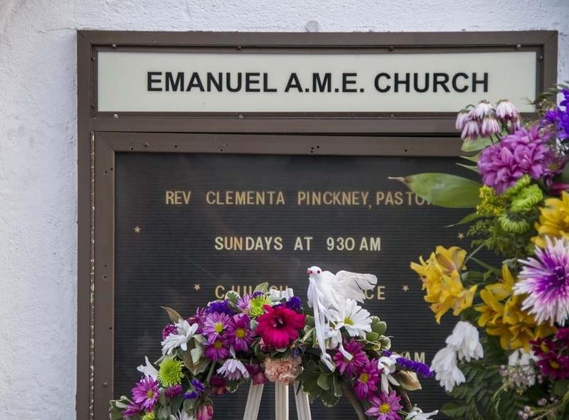 Flowers alongside the Emanuel AME Church information board, photograph by Brandon Coffey, June 29, 2015, Charleston, South Carolina.