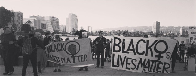 Marchers gathered at the White Silence is Violence march and rally with Black Lives Matter signs, Instagram photograph by Pamela Drake, June 21, 2015, Oakland, California.