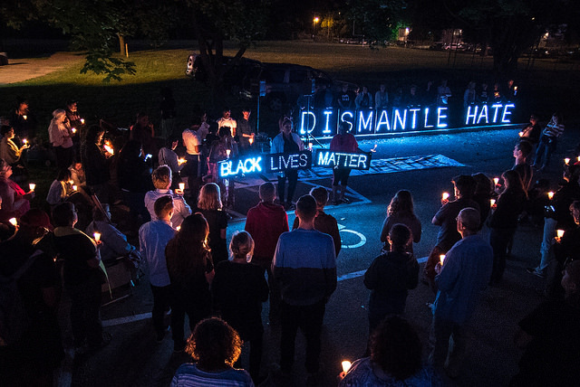 Crowd gathered for a vigil held by the Overpass Light Brigade, June 19, 2015, Madison, Wisconsin, courtesy of Light Brigade.