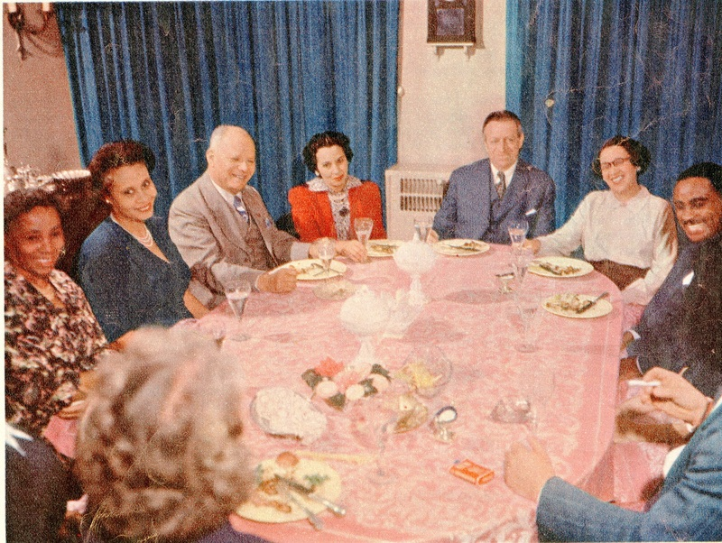 "Septima Clark (far left) and Ruby Cornwell (second from left) sharing a meal with the Warings and other Black leaders in Charleston, ca. 1950, photograph in Collier's magazine article entitled ""The Lonesomest Man in the World,"" courtesy of Collier's Magazine."