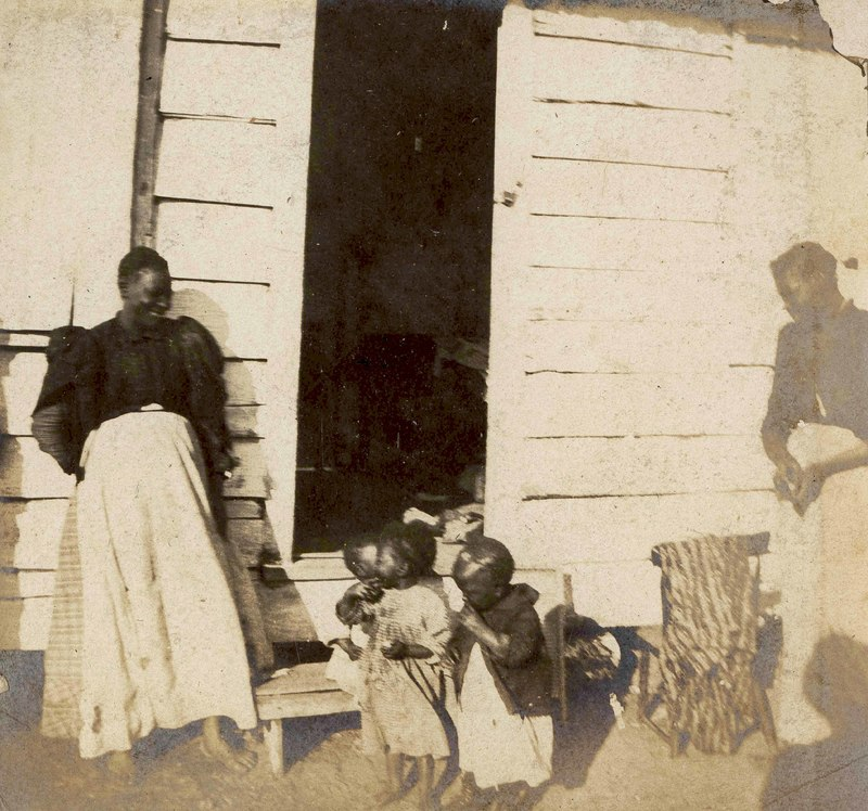 Women and children near cabin steps, Conrad Donner, Beaufort County, circa 1900, courtesy of Avery Research Center For African American History and Culture.