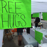 Volunteers offer free water and free hugs at tables set up near the Mother Emanuel Church, June 25, 2015, Charleston, South Carolina, courtesy of ABC New4 WCIV-TV.