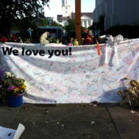 A banner placed outside the Emanuel AME Church filled with messages and prayers, photograph by Meg Moughan, July 7, 2015, Charleston, South Carolina.