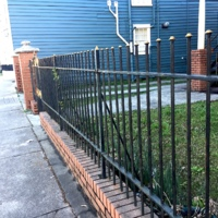 A gate made by Philip Simmons, 92 Morris Street, photograph by LDHI, 2021.