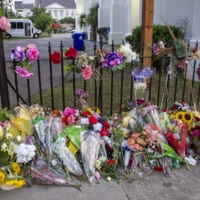 Flowers and other items placed at the Emanuel AME Church, photograph by Brandon Coffey, June 29, 2015. Charleston, South Carolina.