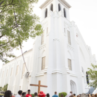 People gather outside of Emanuel AME Church for a prayer vigil, photograph by Sarah Goldman, June 19, 2015, Charleston, South Carolina.