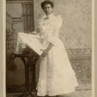 Avery graduate with her diploma, ca. 1886, courtesy of the Avery Research Center.