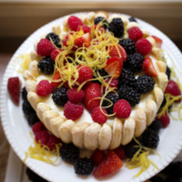 Charlotte Russe Cake topped with fresh berries and a citrus garnish, photograph by Jonathan Boncek, Charleston, South Carolina, April 19, 2015.