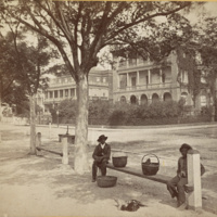 Photograph of two African American children on a bench with baskets at the Battery, Charleston, South Carolina, ca. 1860-1870, courtesy of Library of Congress.