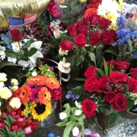 Flowers left by visitors at the Emanuel AME Church, photograph by Toni Carrier, June 25, 2015, Charleston, South Carolina.