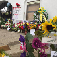 Flowers left outside of the Emanuel AME Church, June 25, 2015, Charleston, South Carolina, courtesy of ABC New4 WCIV-TV.