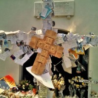 A large cross covered in messages and prayers left at the Emanuel AME Church, photograph by Toni Carrier, June 23, 2015, Charleston, South Carolina.
