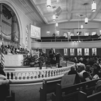 A pastor giving a sermon at Big Bethel AME Church during the vigil honoring victims at the Emanuel AME Church, photograph by Calvin Lionel, June 19, 2015, Atlanta, Georgia.