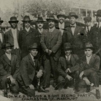 """Dr. W. E. B. Du Bois & Sight Seeing Party,"" Charleston, South Carolina, 1917, courtesy of the Avery Research Center. W. E. B. Du Bois (center), Avery Principal Benjamin Cox (top row, fourth from left). Du Bois, a founding member and leader of the NAACP, visited Charleston in March 1917 to rally community support for the city's newly formed NAACP branch. Teddy Harleston and other founding members of the Charleston branch met with Du Bois during his visit."