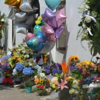 Flowers, balloons, and other items left at the Emanuel AME Church, June 25, 2015, Charleston, South Carolina, courtesy of ABC New4 WCIV-TV.