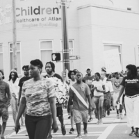 Marchers walking from the Georgia State Capital to Big Bethel AME Church for a march and vigil in honor of the victims at the Emanuel AME Church, photograph by Calvin Lionel, June 19, 2015, Atlanta, Georgia.