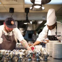 Chefs Sean Brock and Kevin Mitchell finalizing dishes at Nat Fuller's Feast event, photograph by Jonathan Boncek, Charleston, South Carolina, April 19, 2015.