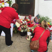 Visitors stop to pray and leave flowers outside the Emanuel AME Church, June 25, 2015, Charleston, South Carolina, courtesy of ABC New4 WCIV-TV.