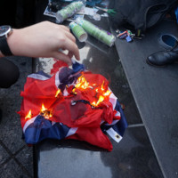 Participants at the NYC Stands with Charleston Vigil and Rally burn the Confederate flag, photograph by The All-Nite Images, June 22, 2015, New York, New York.