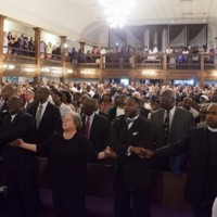 Attendees singing at the Morris Brown AME Church Community Prayer Vigil the day after the shooting, photograph by Mike Ledford, June 18, 2015, Charleston, South Carolina.