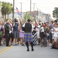 "A member of the Charleston Police Pipes and Drums plays ""Amazing Grace"" outside of Emanuel AME Church, photograph by Sarah Goldman, June 19, 2015, Charleston, South Carolina."