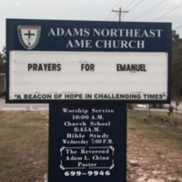 A sign at the Adams Northeast AME Church calls for prayers for the Emanuel AME Church community, June 2015, Columbia, South Carolina.