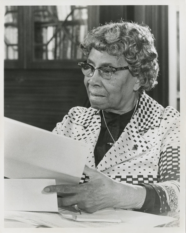 Septima P. Clark sitting at a desk with papers during filming for television documentary about her, Septima P. Clark Papers, courtesy of the Avery Research Center.