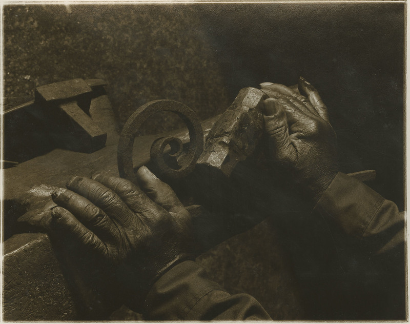 Photograph of Philip Simmons hands holding hammer and scrolled piece of iron, ca. 1995, Philip Simmons Collection, courtesy of the Avery Research Center.