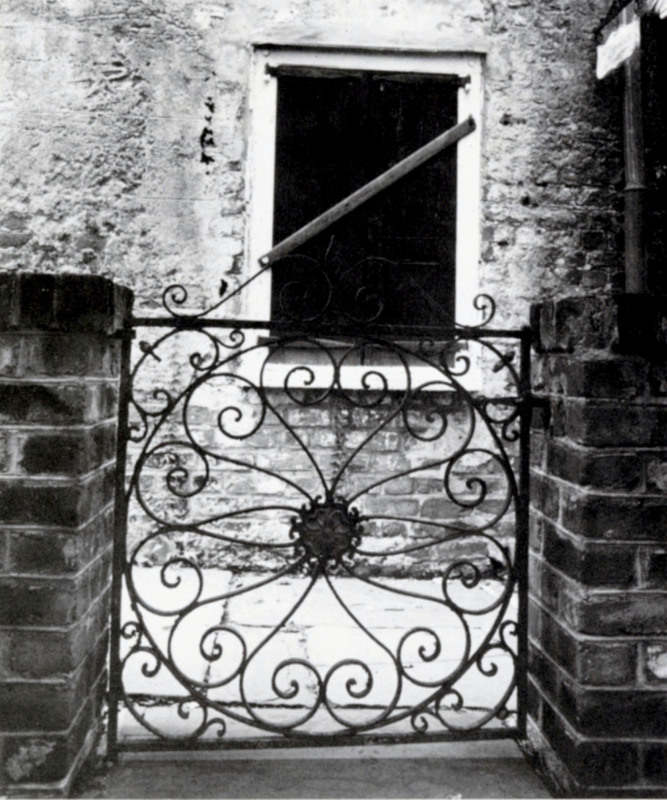 """""""Garden Gate,"""" 313 King Street,Charleston, South Carolina, 1993, photograph by Claire Y. Greene,<em>Keeper of the Gate</em><em>: Designs in Wrought Iron by Philip Simmons, Master Blacksmith</em>, courtesy of the Philip Simmons Foundation."""