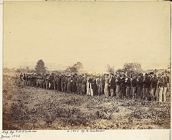 """""""Confederate prisoners at Fairfax Court House,"""" photograph by Timothy H. O' Sullivan, Fairfax, Virginia, 1863, courtesy of the National Archives and Records Administration."""