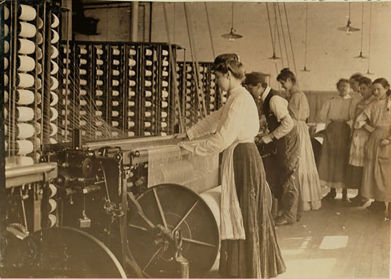 """Type of young woman at spinning machine in cotton mills,"" Newberry, South Carolina, December 1908, courtesy of the Library of Congress, Prints and Photographs Division, National Child Labor Committee Collection."