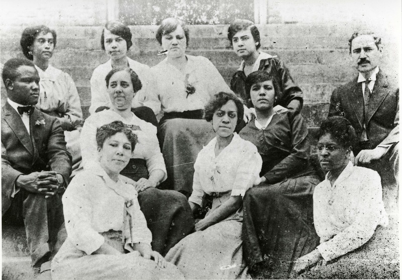 Faculty at Avery, Charleston, South Carolina, ca. 1916, courtesy of the Avery Research Center. This photograph includes Principal Cox (seated middle row, far right) and his wife Jeannette Cox (seated first row, left).  Other faculty pictured: A. W. Murrell, H. L. Green, E. B. Spencer, S. E. Hamilton, F. A. Clyde, E. P. Morrison, A. E. Hill, H. W. McLennan, and A. L. Demond.