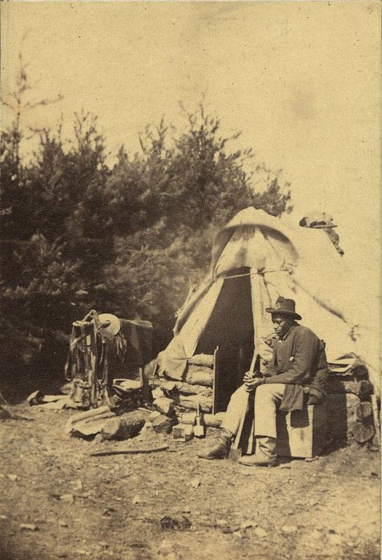 <span>African American man sitting outside a military camp tent</span>, ca. 1863, courtesy of the Gladstone Collection, Library of Congress Prints and Photographs Division.