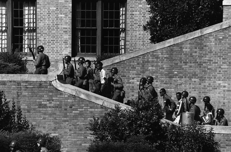 """The """"Little Rock Nine"""" being escorted by the 101st Airborne Division of the United States Army into Central High School, 1957, Little Rock, Arkansas, courtesy of the Library of Congress."""